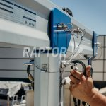 Raptor davits in action performing facade maintenance